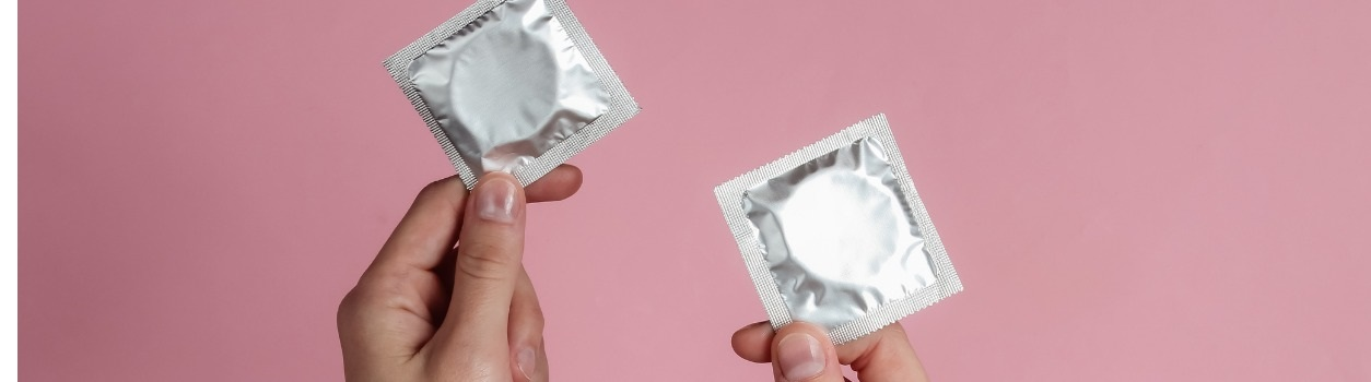 woman holding condoms